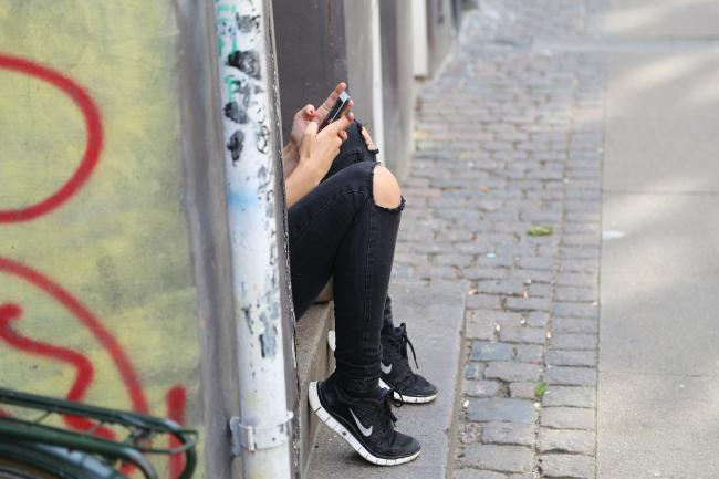 Girl on mobile phone. From Pixabay