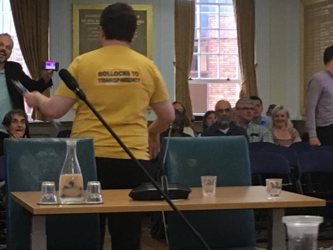 Campaigner James Giles sports a slogan t-shirt at Kingston Council on July 9. Image via ourkingston.org.uk