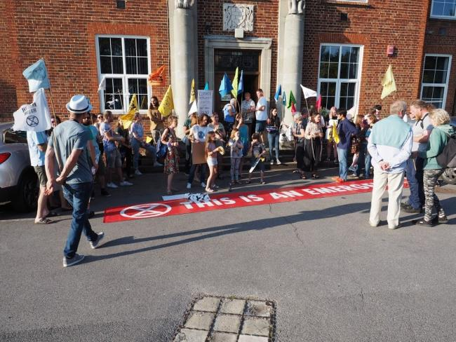 Around 50 campaigners gathered outside the school