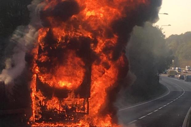 Surrey Fire and Rescue battle bus fire blaze on M25