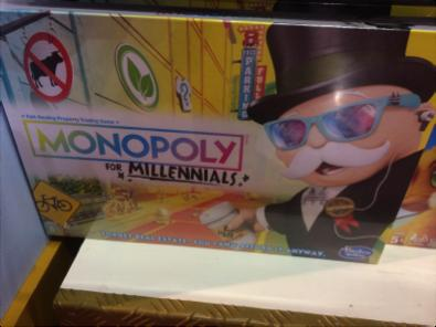"Monopoly for Millennials, found in Hamely's London, stating ""forget real estate- you can't afford it anyway!"""