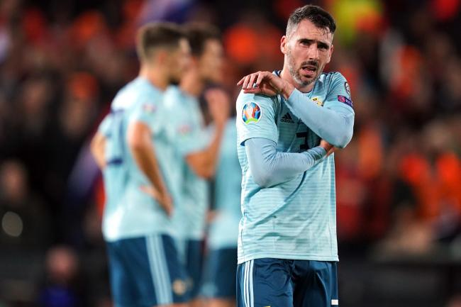 Northern Ireland's Michael Smith appears dejected after Holland's late goals