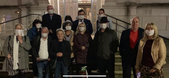 Campaigners outside the Guildhall at Kingston Council. They wore masks with \'silenced\' written across them to protest the new changes to the constitution. No credit required. Free for use by partners of BBC news wire service