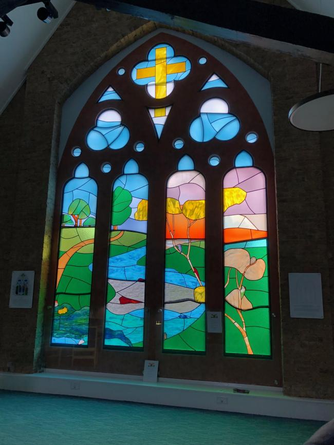 The Church's elaborate and vibrant stained-glass window.