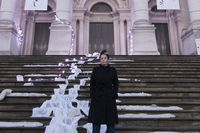 Artist Anne Hardy standing next to her artwork at Tate Britain