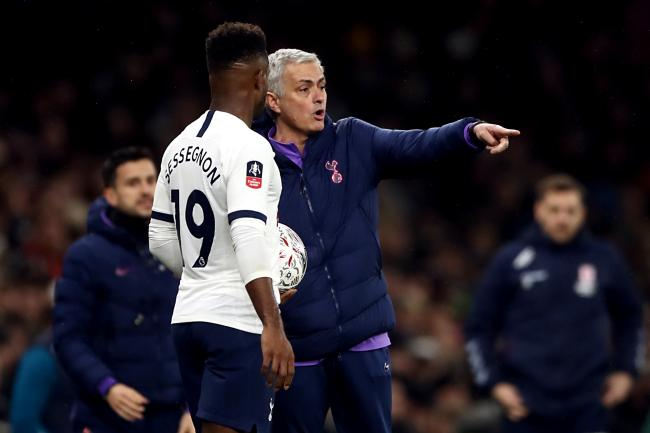 Jose Mourinho, right, issues instructions to Ryan Sessegnon