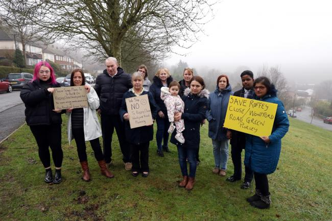 CRDC20200122B..A group of neighbours in Wontford Road and Roffey Close have started a campaign to save a strip of land in between the two roads from development. Group portrait of the protesting residents at the site near Old Lodge Lane...PLEASE CREDIT..P