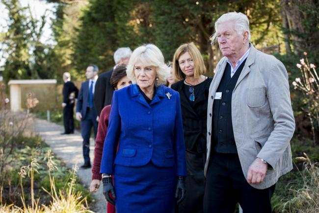 The Duchess of Cornwall walks through the garden with the landscaper Piet Oudolf during a visit to Maggie's at the Royal Marsden Hospital in Sutton, Surrey. PA Photo. Picture date: Thursday February 6, 2020. See PA story ROYAL Camilla. Photo credit sh