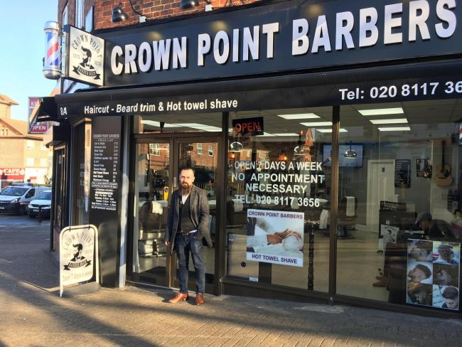 Ako Hama Amin runs Crown Point Barbers. Credit: Tara O\'Connor. Free for use by all BBC wire partners.