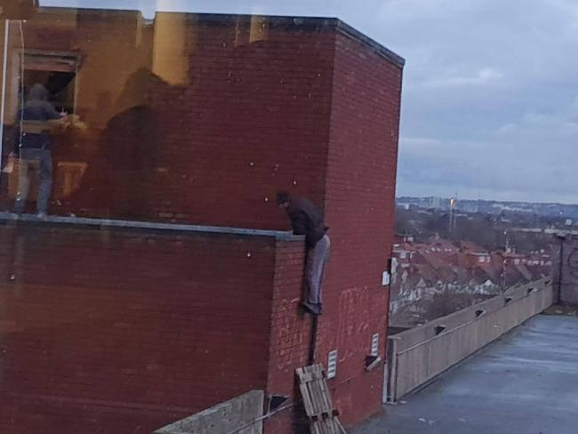 People seen climbing on the Blagdon Road multistory carpark in New Malden. Image: Elena Brockhouse