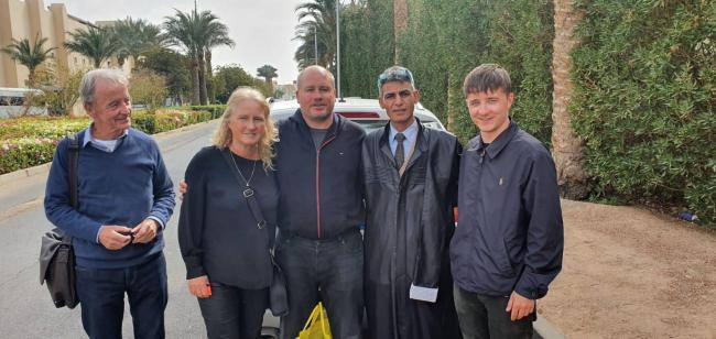 Undated family handout photo issued by Detained in Dubai of (left to right) John Kenny from the British consulate, Joan and her husband Tony Camoccio, lawyer Elezab Ali Elezab and Remo Camoccio, as British father-of-four Tony who was arrested for reported