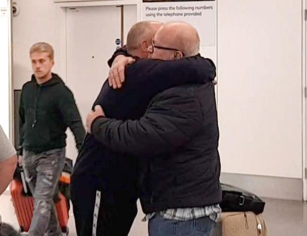 Sutton man detained in Egypt over 'pat on back' tired but happy after flying home