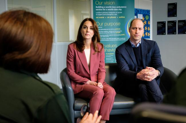 Handout picture released by Kensington Palace of the Duke and Duchess of Cambridge talking with staff during a visit to the London Ambulance Service 111 control room in Croydon
