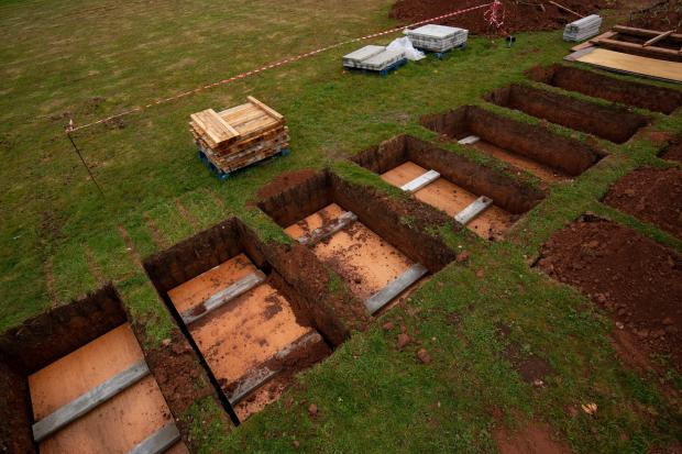 Rows of new graves being prepared at High Wood Cemetery, Nottingham