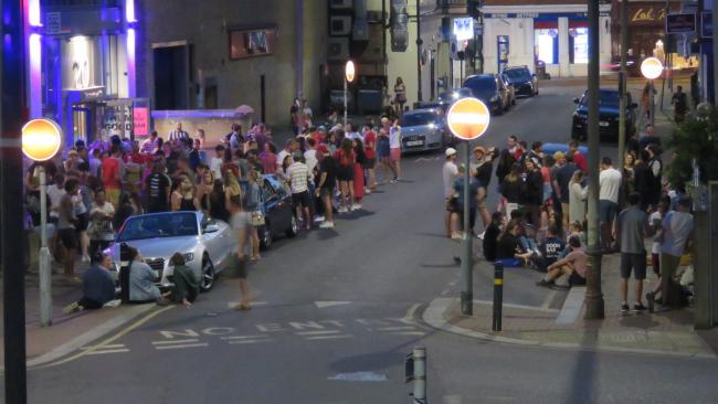 Crowds gather on Totterdown Street near Tooting market on June 27. Image: Brionie Sherriff