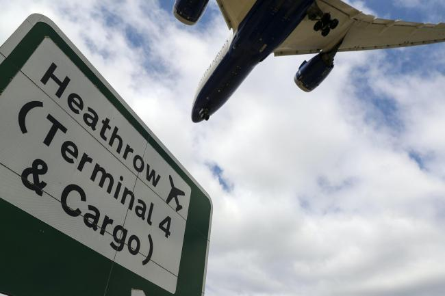 Plane over Heathrow sign