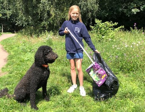 Your Local Guardian: Scarlett tackles litter in Crane Park with her dog.