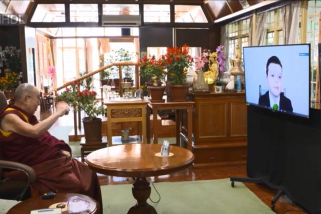 The Dalai Lama speaks with Croydon students via a video conference call. Image via WHD