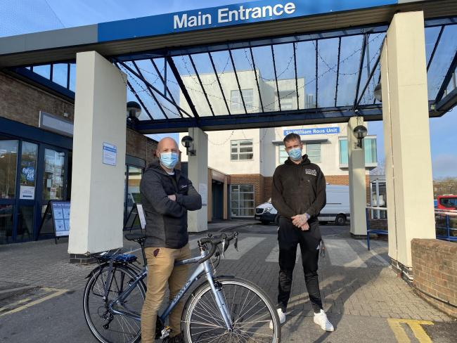 Dr Wilcox and Ben Maclean with a new bike at Kingston Hospital. Image: KHNHSFT