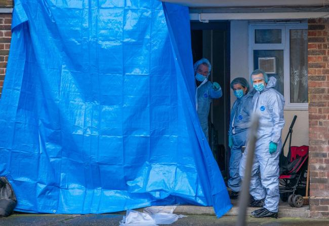Forensics officers at the scene of a fatal stabbing in Croydon. Image: Dominic Lipinski/PA Wire .