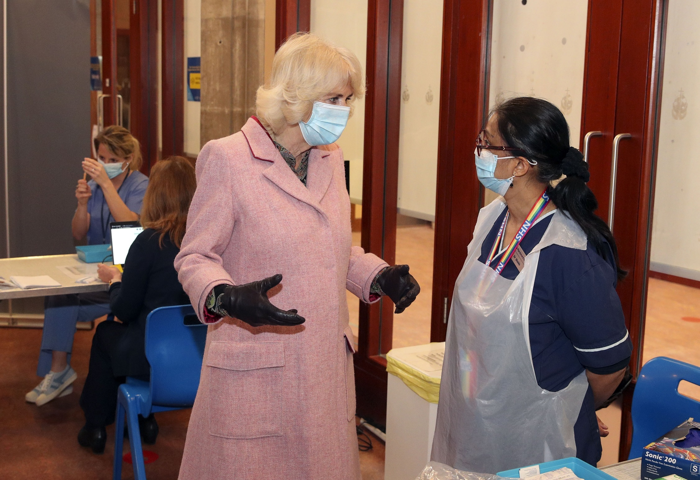 The Duchess of Cornwall talks to Dr Shaikh (right) during a visit to the Community Vaccination Centre at St Pauls Church