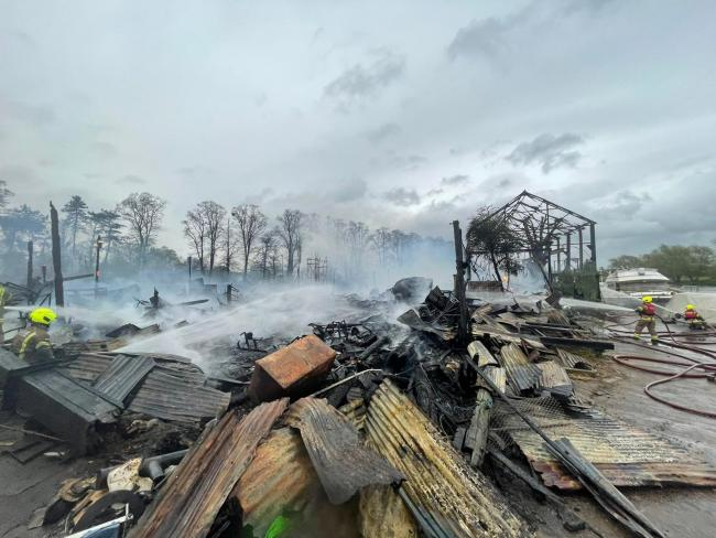 Historic boatyards destroyed in huge fire on Platt's Eyot Island. [Image: LFB]