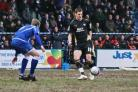 On target:  Brentford's Ben Strevens in action at Stockport County.  Pic: Gary Paul.