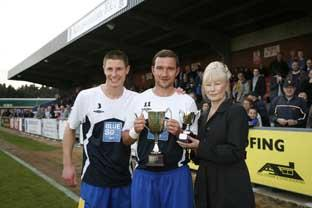 Kedwell receives Player's Player of the Year from skipper Paul Lorraine and Maureen Batsford