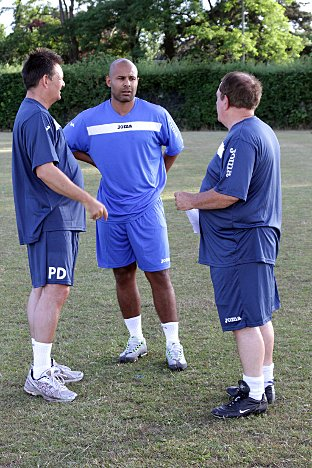 New boy?: Sutton boss Paul Doswell and Alan Payne work on potential new signing Simon Downer at training last week.