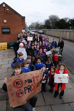 Last-ditch plea: Parents and children gathered at the site of the proposed mast, by the Avondale Road bus station in North Worple way, Mortlake, on Wednesday, to show their determination to bring the plan to a