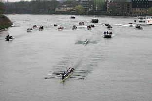 The Oxford boat crew cross the finish line