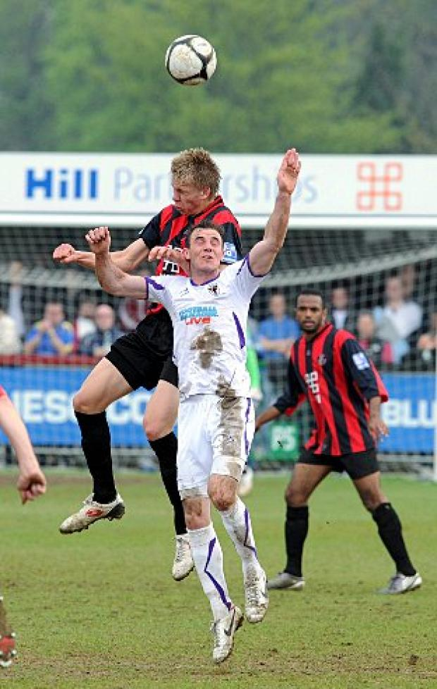 On the double: Luke Moore goes up for a header against Histon on Saturday. Cambridge News