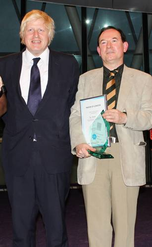 Jad Adams with Mayor Boris Johnson and his award