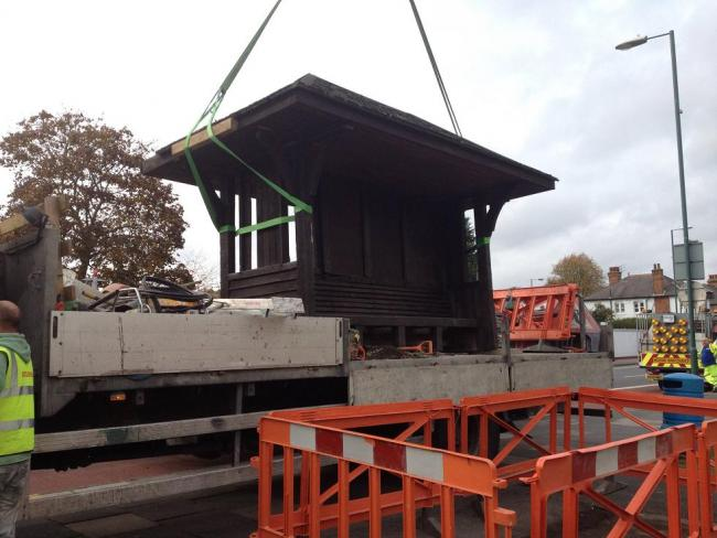 The bus shelter being removed