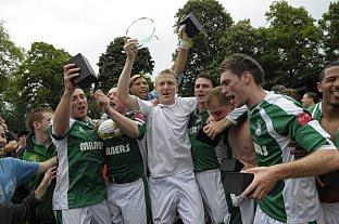 Happier days: Chris Boulter, pictured in the centre in white, leads the celebrations last May when Leatherhead won promotion to the Ryman Premier