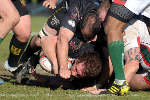 Touchdown: Esher's Mike MacFarlane scores one of his two tries in Saturday's win