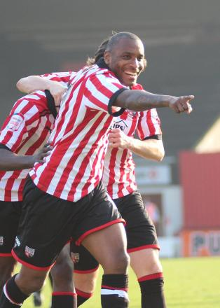 Off on the right foot: Brentford loan signing Clinton Morrison helps Clayton Donaldson celebrate his goal against Rochdale on Saturday