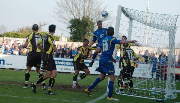 Your Local Guardian: Easy street: Byron Harrison heads home for this first Dons goal on Saturday...