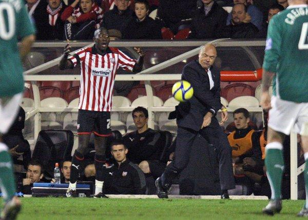 Fired up: Brentford boss Uwe Rosler, right, is ready for action