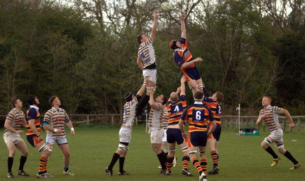 eaching for safety: Purley John Fisher captain Neil Leather wins a line-out during Saturday's victory