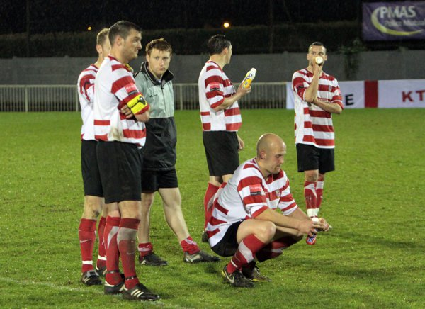 Down and out: Kingstonian players cannot hide their disappointment, but how many of these faces will be around to put things right next season?