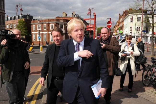 Boris Johnson in Surbiton flanked by former councillors Nick Kilby, left, and Ian George, right