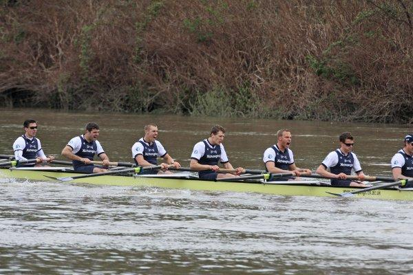 Broken men: Oxford limp over the line in the Boat Race with their broken oar visible