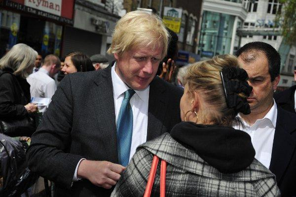 Boris Johnson talks to shoopers in Sutton High Street ahead of the Mayoral elections