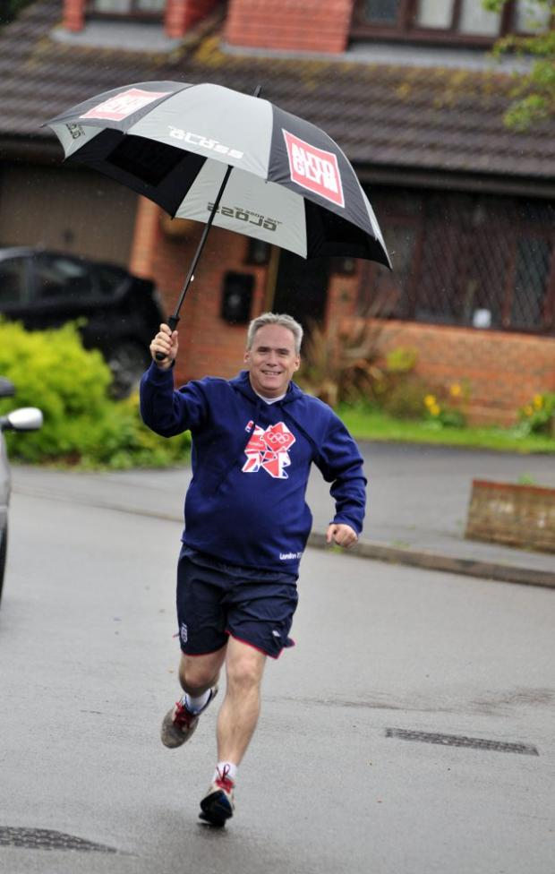 Banstead leading rotarian chosen to carry Olympic torch