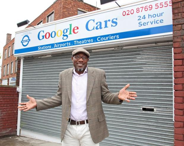 Kaz Odutayo outside Gooogle Cars in Streatham High Road.