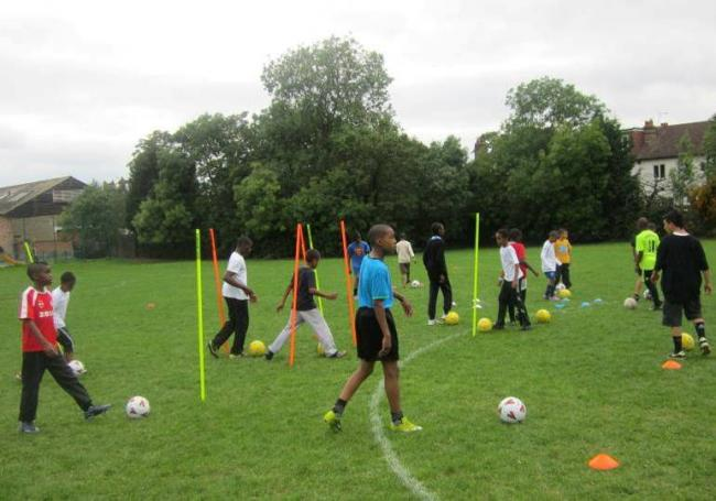 Youngsters playing at the football academy in Streatham