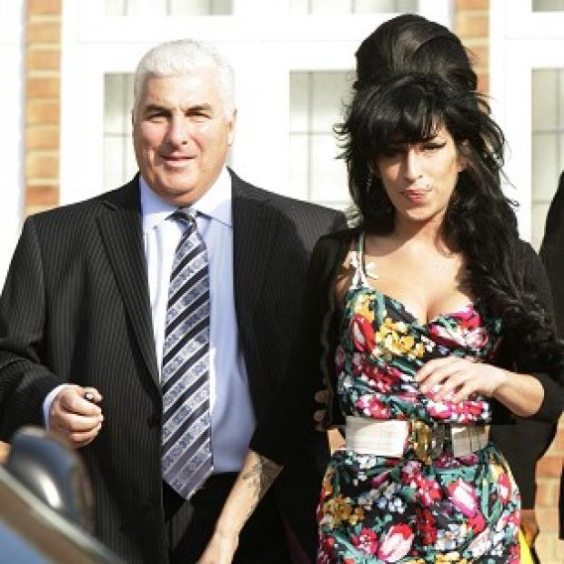 Mitch Winehouse said he still texts his late daughter Amy