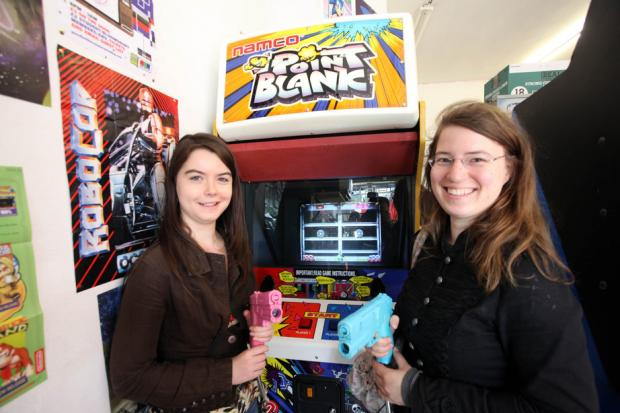 Sophia Start and Sarah Buck try out the games in store.
