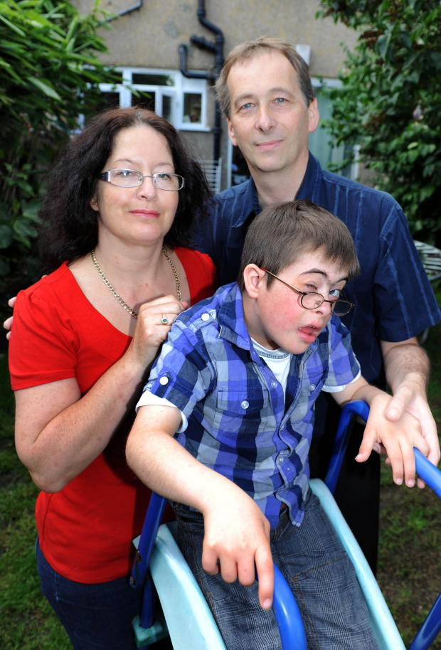 Tracy Eaton with husband Raymond and 11-year-old Samuel, whose place was turned down by a Tooting school